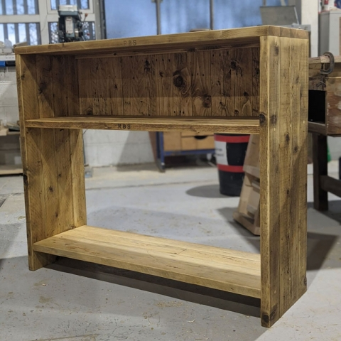 Custom console table with pallet wood backed top storage