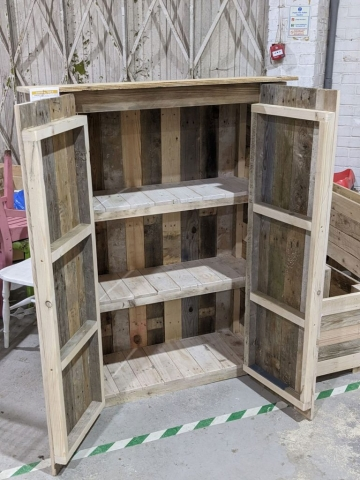 Outdoor storage unit made with reclaimed pallet wood