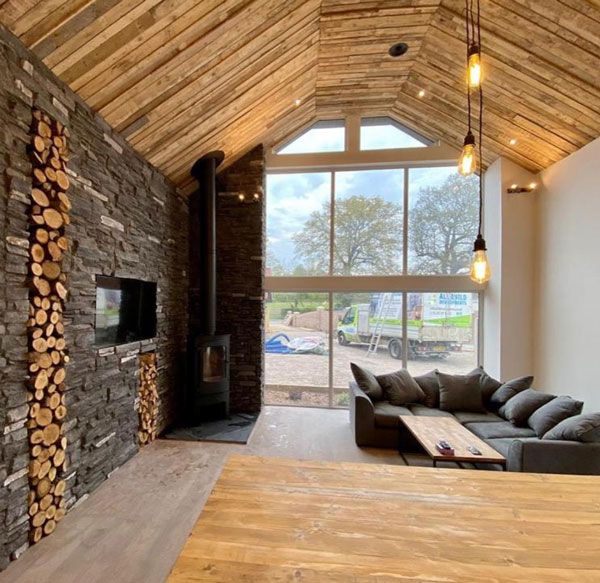 Large table and pallet wood for ceiling in holiday cottage