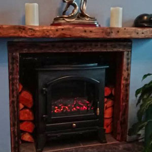 Chunky mantelpiece made from reclaimed wood