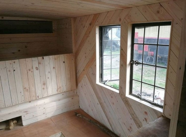 Horse box conversion with varied angled pallet cladding